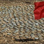 A red flag marks unexploded land mines in Lybia. Photo: BBC