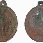 """A 19th Century Catholic medallion was a """"highly personal item"""" found at the dig."""