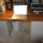 """The """"new"""" desk made from two filing cabinets and a salvaged particle board desk top."""
